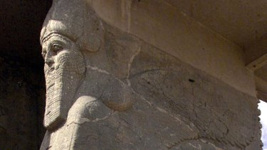 Destroyed: An ancient statue of a winged bull with a human face in Nimrud.