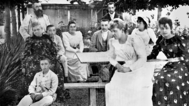 The Monet-Hoschede family under the lime trees at Giverny in 1886, Claude Monet top left, his two sons at left and his wife's daughters at right.
