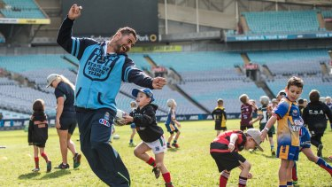 Tip! NSW Blues player Andrew Fifita tries to get away from a dogged defender at ANZ Stadium.