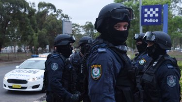 Members of the Middle Eastern Organised Crime Squad raid a house in western Sydney to look for suspected firearms.