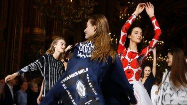 Models dance flashmob style.