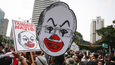 Student activists hold up a caricature of Malaysian Prime Minister Najib Razak in Kuala Lumpur in August.