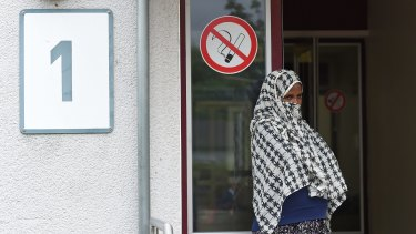 A woman stands outside the refugee registration camp in Friedland, central Germany, on Tuesday.