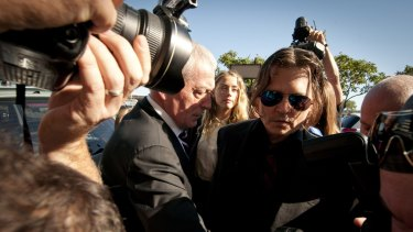 Johnny Depp and Amber Heard outside court.