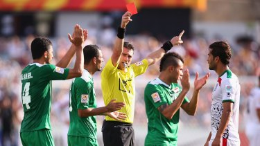 Referee Ben Williams sends Mehrdad Pooladi off in the Asian Cup quarter-final between Iran and Iraq at Canberra Stadium.