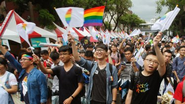 Same-sex marriage supporters cheer after Taiwan's Constitutional Court ruled in favour of it.