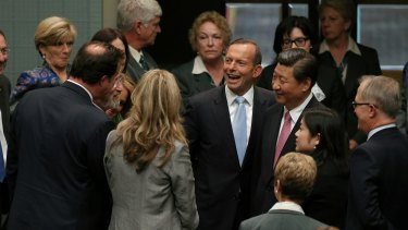 Chinese President Xi Jinping is introduced to members and senators by Prime Minister Tony Abbott following his address.