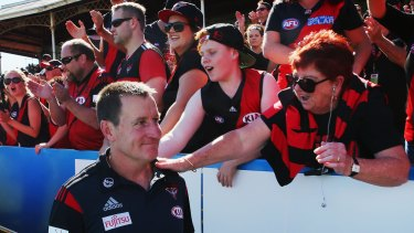 Winning feeling: Bombers coach John Worsfold greeted by fans at Ikon Park.