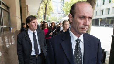 Brothers Chris, front, and Gerry Apostolatos at the Melbourne Magistrates Court on Wednesday.