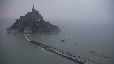 Before: an aerial view shows the Mont Saint-Michel off France's Normandy coast.