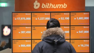 A man watches a screen showing the prices of bitcoin at a virtual currency exchange office in Seoul, South Korea.