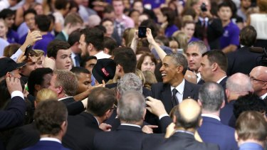 US President Barack Obama greets audience members after his speech at the University of Queensland.