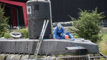 Police technicians on board the home-made submarine UC3 Nautilus.