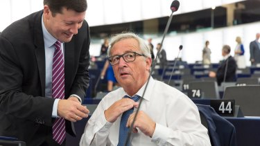 'Not enough union': Jean-Claude Juncker adjusts his tie as he prepares to deliver his  address.