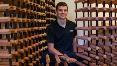 Mathew Childs with his wine storage products.