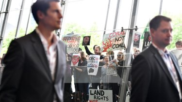 People protest against the Carmichael coal mine outside the International Mining and Resources Conference in Melbourne on Wednesday.