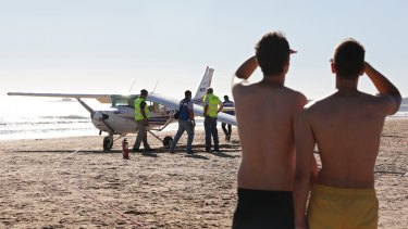 Sao Joao beach in Portugal was packed with sunbathers when the plane landed.