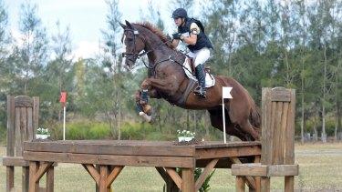 Caitlyn Fischer riding Ralphie.