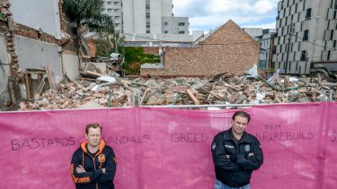 Trades Hall secretary Luke Hilakari, left, and CFMEU boss John Sekta in front of pub's remains. Unions last week banned construction on the site.