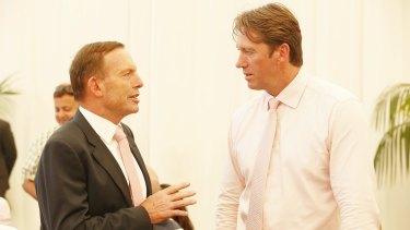 Busy man: Tony Abbott talks to Glenn McGrath on Jane McGrath day at the SCG.