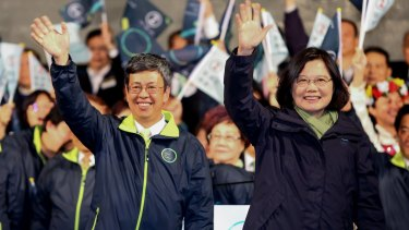 Tsai Ing-wen, Taiwan's president-elect, right, and Chen Chien-jen, vice-president-elect, left, wave to supporters after delivering a victory speech in Taipei, Taiwan, on January 16.