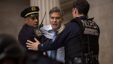 George Clooney displays his acting prowess as TV star Lee Gates in <i>Money Monster</I>.