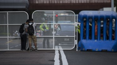 Police officers adjust barricades near the convention centre in the Wan Chai district of Hong Kong on Monday.