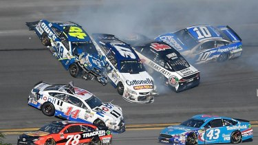 Jimmie Johnson (48), Clint Bowyer (14), Chris Buescher (37), Kevin Harvick (4) and Danica Patrick (10) collide between turns three and four.