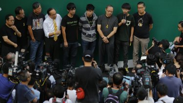 Members of the student movement speak to the media in Hong Kong.