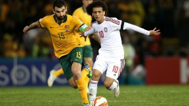Zero-sum game: Mile Jedinak competes against UAE's Omar Abdulrahman. Australia's success in qualifying for World Cups is seen as taking away a spot from the rest of the Confederation.