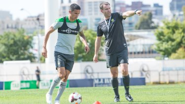 Tim Cahill with coach Ange Postecoglou during a training session in Melbourne on Sunday.