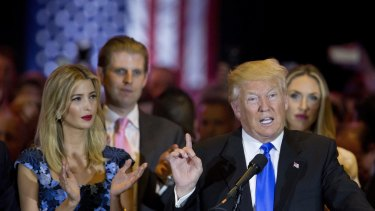 Ivanka Trump listens to her father, Republican presidential candidate Donald Trump, speak.