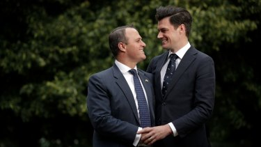 Liberal MP Tim Wilson with his partner, Ryan Bolger, at Parliament House.