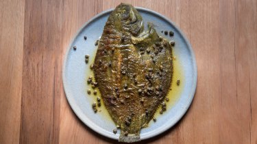 The flounder is sluiced in simple brown butter with lemon and capers.
