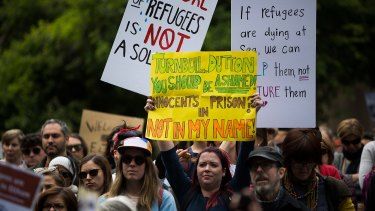 Protesters are seen at the march for refugees in Melbourne CBD.