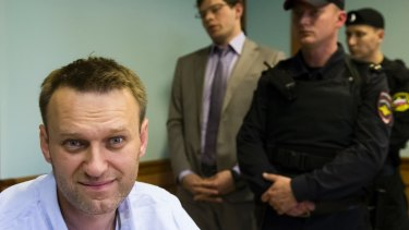 Russian opposition leader Alexei Navalny, left, sits during a hearing over his arrest in Moscow on June 16.