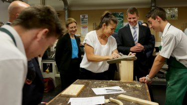 Premier Mike Baird launched the $86 million Reskilling NSW plan on Monday at Georges River College.  Teacher Nikyetta Pencheff and student Andrew Batten showed the Premier some of the hands-on courses available.