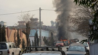 Vehicles burn after the second blast, from a parked car, in Jalalabad on Wednesday.