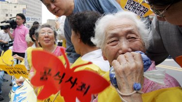 A former South Korean 'comfort woman' Lee Sun-duk, right,  and others who suffered indignities in WWII,  at a protest in Seoul in 2007.