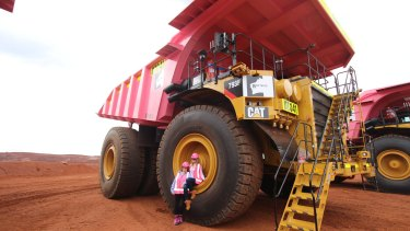 Gina Rinehart and daughter Ginia on a pink mining truck at the Roy Hill iron ore mine.