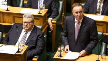 John Key delivers a ministerial statement regarding New Zealand's contribution to the coalition against ISIL while Defence Minister Gerry Brownlee looks on.