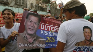 Duterte supporters hold a campaign banner in the capital Manila.