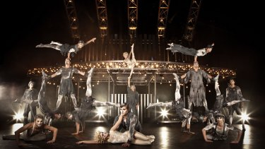 Performers in Quidam's banquine act with the telepherique in the background.