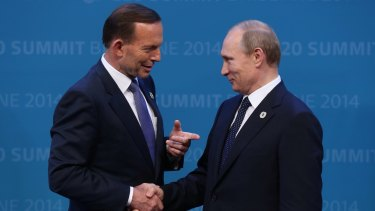 Former Prime Minister Tony Abbott greets Russian President Vladimir Putin at the 2014 G20 Summit in Brisbane.