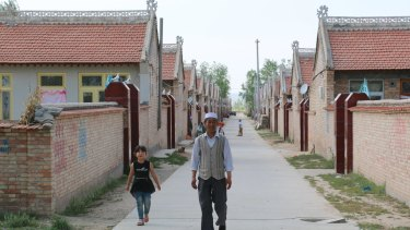 Hai Fuquan, 58, at a new resettlement village assigned to ecological migrants. The Ningxia government has moved about 350,000 people from ecologically fragile mountain areas to plains where they can better access water.