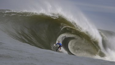 Evan Faulks rides a wave at Cape Fear, off the coast of Kurnell.