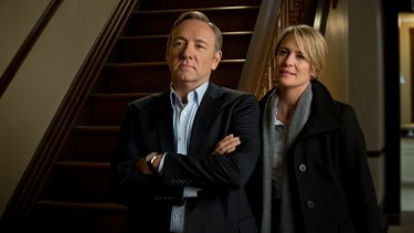 Kevin Spacey as Frank Underwood, with co-star Robin Wright, in House of Cards.