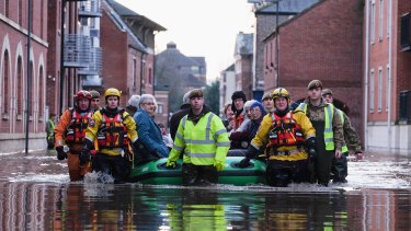 A rescue team assists members of the public as they are evacuated from the Queens Hotel in York city centre.