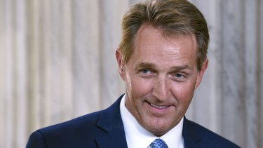 Senator Jeff Flake, who is not seeking re-election, donated to a Democrat rival to Roy Moore.