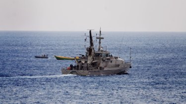 An Australian Naval vessel approaches a suspected refugee boat off the coast of Christmas Island.